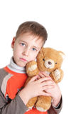 Sad boy with a soft toy Stock Photos