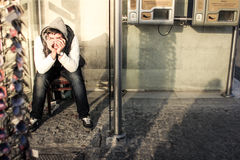 Sad boy in the street.JPG. Sad boy in the street with retro color and high contrast.JPG royalty free stock image
