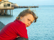 Sad boy in sunset. Portrait of sad boy in sunset stock photo