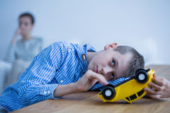 Sad boy with toy car Royalty Free Stock Photos