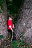 Sad boy at the tree Stock Photos