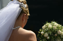 Sad bride. The bride with a bouquet on a dark background Royalty Free Stock Photo