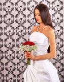 Sad bride in wedding dress Stock Photos