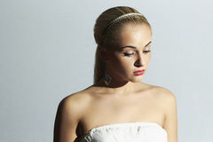 Sad bride in white dress. Beautiful blond woman Royalty Free Stock Photo
