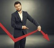 Sad broker holding graph Stock Photos