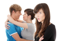 Sad brunette girl jealousy about her friend Stock Photo