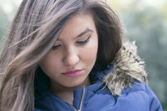 Sad brunette girl Stock Images
