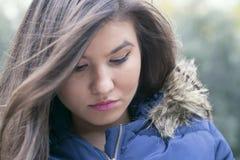 Sad brunette girl Stock Images