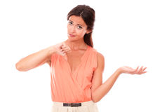 Sad brunette lady with thumb down. Gesturing a bad job while looking at you disappointed and unhappy in white background - copyspace Stock Photo
