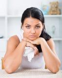 Sad brunette wipes tears Royalty Free Stock Photo