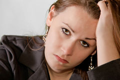 Sad brunette woman Royalty Free Stock Photo