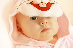 Sad bunny. Sad baby girl under a mask of pink rabbit Royalty Free Stock Images