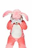 Pink rabbit suit isolated on white background. Sad bunny isolated on white background Royalty Free Stock Photo