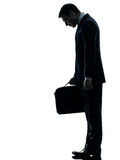 Sad business man  looking down silhouette Stock Photos