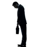 Sad business man  looking down silhouette Stock Image