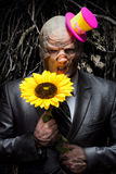 Sad business monster with sunflower Royalty Free Stock Images