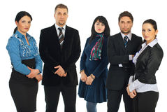 Sad business people in a row. Sad serious five business people standing in a row and looking at camera isolated on white background Stock Images