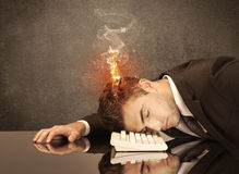 Sad business person's head catching fire Stock Images