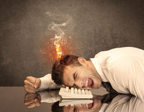 Sad business person's head catching fire Royalty Free Stock Photos