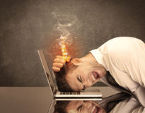 Sad business person's head catching fire Stock Image