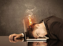 Sad business person's head catching fire Royalty Free Stock Photo