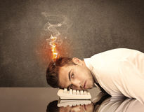 Sad business person's head catching fire Royalty Free Stock Image