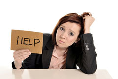 Sad business red haired woman in stress at work with computer Stock Photos