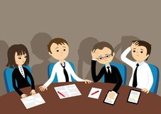 Sad business team. Sad business people are sitting at the table Stock Image