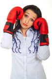 Sad business woman with boxing gloves Stock Photo