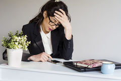 Sad  business woman in office with phone in the hands Royalty Free Stock Photo
