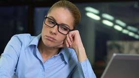 Sad business woman sitting office desk, feeling tired routine work, exhaustion stock footage