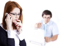 Sad business women calling by phone. Royalty Free Stock Photos