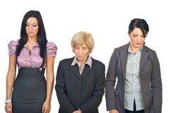 Sad business women in a row stock image