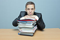 Sad businessman. In an office royalty free stock photo