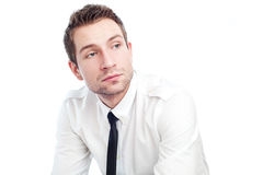 Sad businessman. Portrait of sad businessman sitting isolated on white Stock Photography