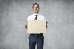 Sad businessman with box Stock Photos