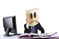 Sad businessman with cardboard head Stock Photography