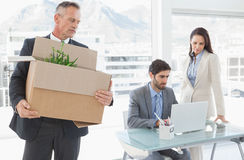 Sad businessman carrying a box Royalty Free Stock Photography