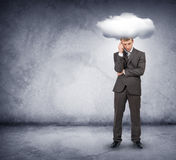 Sad businessman with cloud above head Royalty Free Stock Image