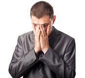 Sad businessman covering face by hands Royalty Free Stock Photo