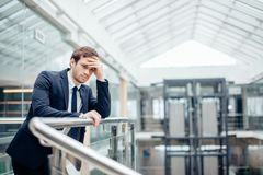 Sad businessman covering his face with his hand. Man got bad news.Stress Stock Image