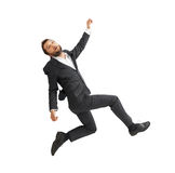 Sad businessman falling down. Over white background Royalty Free Stock Photography