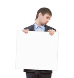 Sad businessman holding a white blank Stock Photo