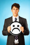 Sad Businessman With Icon Royalty Free Stock Image
