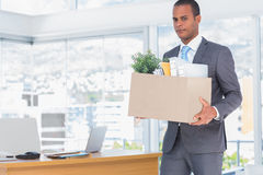 Sad businessman leaving his company Stock Images