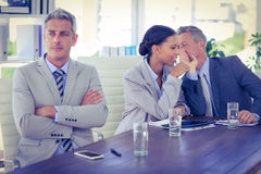 Sad businessman looking aways while his colleagues speaks Royalty Free Stock Photo