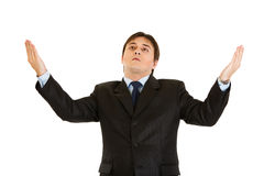 Sad businessman looking up and  raising his hands Stock Photo