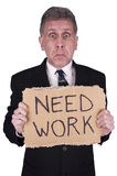 Sad Businessman Need Job, Work Unemployed Isolated. Sad businessman in need of a job. This male white collar worker in suit and tie holds a cardboard Need Work Stock Photo