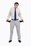 Sad businessman showing his empty pockets Royalty Free Stock Photo