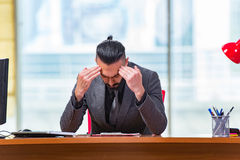 The sad businessman sitting in the office Royalty Free Stock Photos